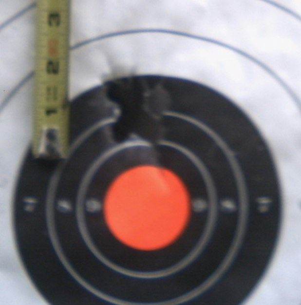 a shotgun is a sucker's choice of a shtf longarm, almost as bad as a muzzleloader.-50cal50yds5shts.jpg
